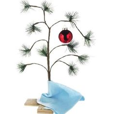 "Charlie Brown  Christmas Tree  Tabletop 2-FT  Keepsake  Official 24"" replica of the Charlie Brown Christmas Tree  The Peanuts Christmas Tree Charlie Brown is Decorated with the classic red bulb ornament and Linus's blue blanket  Wooden base features the official Peanuts logo for authenticity"