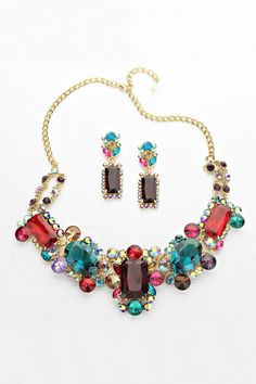 Crystal Etta Statement Necklace Set Gorgeously stunning this Necklace is simply Breathtaking, Ruby, Raspberry, Champagne, Amethyst, Aquamarine, Teal and Sapphire Crystals set against Gold. Necklace includes matching Statement Earrings.