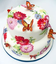 This painted cake matches a vintage tea cup - butterflies were a fun addition