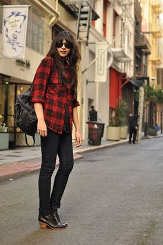 Shop this look on Lookastic:  http://lookastic.com/women/looks/ankle-boots-skinny-jeans-backpack-crew-neck-t-shirt-dress-shirt-sunglasses/6480  — Black Leather Ankle Boots  — Black Skinny Jeans  — Black Leather Backpack  — Black Crew-neck T-shirt  — Red and Black Plaid Dress Shirt  — Black Sunglasses