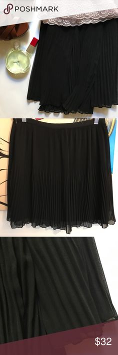 """Zara black pleated skirt * irregular fine pleated skirt in black is a great going out outfit, but it can also be dressed down for daytime * length 17"""" * waistband 31"""" * never worn, new without tag lined * photos 1, 2, 3: mine * photo 4: Zara Zara Skirts"""