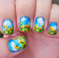Blue sky and sunflower nails