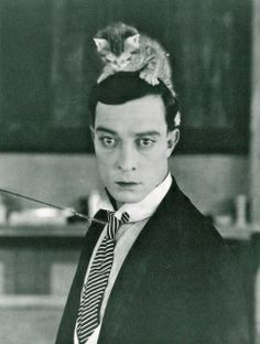 c. 1920: Buster Keaton wearing a cat