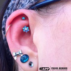 Healed Rook Piercing With An Anatometal Blue Opal Flower And Prong Set Blue Opal With A J Curve. @anatometalinc @safepiercing #appmember #app #safepiercing #rook #piercing #sacredart #newcastle #professionalpiercing