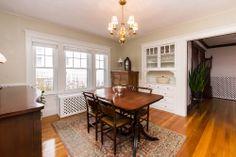 Built in hutch, original hardwood floors, dining room, radiator cover