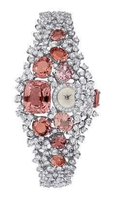 Cartier -High Jewelry Secret Hour Watch -Quartz movement- Rhodium-finish white Gold dial and bracelet set with 10 orange Spinels carats) and 264 brilliant-cut Diamonds carats). High Jewelry, Bling Jewelry, Vintage Jewelry, Bullet Jewelry, Geek Jewelry, Gothic Jewelry, Jewelry Necklaces, Cartier Jewelry, Jewelry Watches