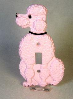 Pink Poodle light switch cover.