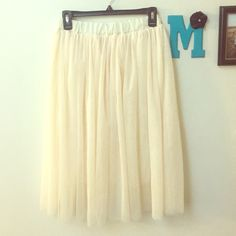 Cream Tulle Skirt One size fits most. Elastic waistband that stretches a lot. Brand new never worn! Skirts