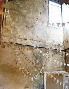 #Snippet for #The Lab2013 - Gorgeous paper bunting done in two-sided silver paper, to catch the flickering light, strung between the rafters of the reception barn. Paper Bunting