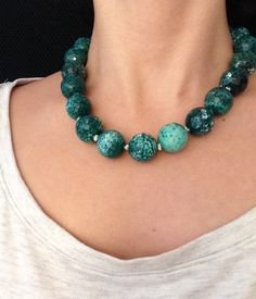 Beautiful green fire agate stones are used to create this necklace. The deep green colour intensifies the beauty of the wearer. It is also known