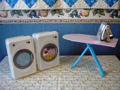 Make your dolls a washer and dryer from empty baby wipes containers.