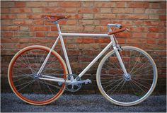 Cream frame, leather-wrapped mustache bars, orange rear wheel, white tires, classy crank wheel | UCY Bicycles