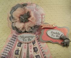 Pink and Silver Elephant Baby Shower Corsage Mommy To Be Corsage Measures: 3 1/2Flower x 7 Ribbon Made from Fabric, Ribbon and Embellishments Please allow 5 Business Days for Processing and 3-5 Days for Shipping Pin attached on Back