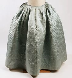 1750-99: Petticoats were worn under dresses and provided structure for the full skirts. The design of the petticoat is highly decorated with a quilted silky style but the material is still very stiff.