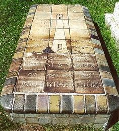 the amazing grave of Alfred Wallis, a famous English primitive painter who died in 1945. Wallis who was a fisherman with no formal training started painting when his wife died, using whatever materials came to hand, including Driftwood and cardboard. Unfortunately, like many others, Wallis was poor and didn't become famous until after his death.