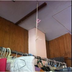 Saw this at a garage sale this weekend. Easy way to hang clothes for cheap. Garden hooks, rope, and conduit pipe: instant rack!
