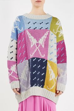 The hand-knit Lindbergh Pullover is a hero piece from the Unique SS17 catwalk. Featuring this season's whimsical pattern of raindrops and umbrellas, this oversized jumper is an unforgettable statement knit.