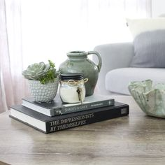 B•O•O•K•S  Coffee table books are a very useful tool when styling a room. They bring warmth and interest, can be used to adjust the height of other objects, as well as to tie a colour scheme together. Taking off the sleeve adds to a feeling of quality. How do you use books?⠀⠀⠀⠀⠀⠀⠀⠀⠀ ⠀⠀⠀⠀⠀⠀⠀⠀⠀ Succulent vase @targetaus⠀⠀⠀⠀⠀⠀⠀⠀⠀ Grey sofa @freedom_australia⠀⠀⠀⠀⠀⠀⠀⠀⠀ Cushion @tkmaxxau Gray Sofa, Coffee Table Books, Shades Of Grey, In The Heights, Color Schemes, Succulents, Freedom, Objects, Cushions