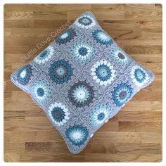 Cushion all finished it's the same on both sides. I used Stylecraft Special DK in Silver grey storm duck egg and white. (Disclaimer: pattern is not mine I'm not a crochet designer. It is the sunburst square by Priscilla Hewitt. The colours were put together to match my customer's decor at her request) by littledovecrochet