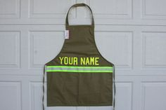 Custom firefighter apron with lettering of your choice, makes a great gift for your fireman.. $25.00, via Etsy.