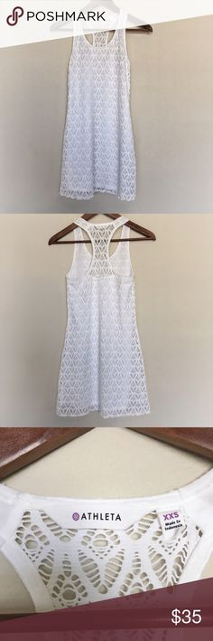 """White Lace Swim Coverup This dress is in perfect, like new condition. Amazing stretchy white crocheted lace, fully lined. I bought on posh and never worn because it doesn't fit me unfortunately. 31"""" long. Athleta Swim Coverups"""