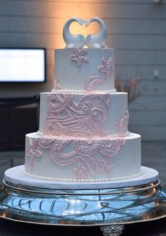 Pink Octopus Wedding Cake.... I just like the topper lol