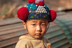 embroidered hat, Muang Sing, Laos; A Red Yao boy wearing a traditional hat.