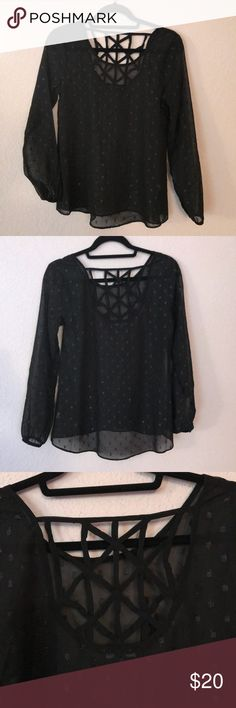NWOT. Moa Moa sheer black blouse Moa Moa sheer blouse looks great with a tank top. Unique design on the back of the blouse.   Smoke free and Pet free home.  15% off 2 or more items when you bundle!  Thanks for checking out my closet and let me know if you have any questions! Moa Moa Tops Blouses