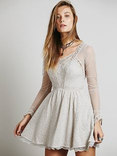 Sweetheart neck,  cleavers lace insertion, cotton woven fabric, stretch chiffon.                                                                  Free People Long Sleeved Victoria Mini at Free People Clothing Boutique