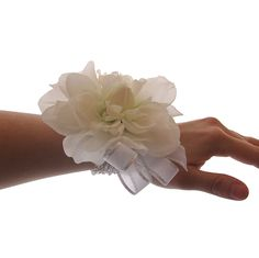 Just in time for prom, this beautiful wrist corsage features a sparkling beaded bracelet decorated with a soft and feminine white dahlia.  Affordable, yet beautiful, this modern corsage is simple and stunning style with a neutral color that will complement many prom dresses.