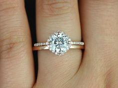 This engagement ring is designed for those who love simple with a slight twist. The round cut in the center is traditional while the cushion halo set. I LOVE THIS!