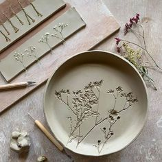 May Share: Top 15 Pins - printed clay plates with dried flowers - Chloe Dominik. May Share: Top Pottery Plates, Slab Pottery, Ceramic Plates, Ceramic Pottery, Pottery Art, Ceramic Art, Clay Plates, Thrown Pottery, Porcelain Ceramics