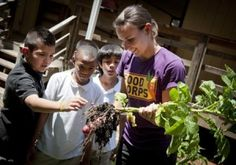 FoodCorps marks first year. Service members serve in local schools to conduct nutrition education, engage students in building and tending school gardens and expand access to local, fresh produce in school cafeterias.