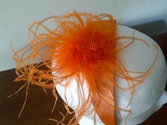 orange feather headband  The feather comes by ladybugladyjjjsalon, $15.90