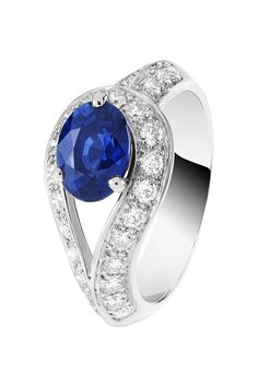 Van Cleef & Arpels Couture Solitaire in platinum, set with round diamonds and a 1.65ct oval-cut sapphire.