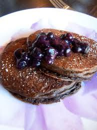 chocolate protein pancakes  ,5 cup oatmeal  6 egg whites  1 scoop chocolate protein powder    Mix all of the above and put into a hot pan. Cook thoroughly on both sides  Heat up 1 cup blueberries in another small pan, add vanilla and cinnamon  Pour on top of your hot pancakes!  mmmmmm super low fat, high protein and low calorie breakfast and also very suitable for post workout meal!