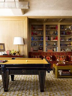 game room - love the mustard colored pool table