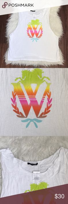"""Wildfox White Raw Hemline Rainbow Logo Tank Top Brand new with tags. Never been worn. No flaws. Raw hemlines. Made from 50% cotton and 50% polyester. Made in the USA. Measures 22"""" across from armpit to armpit and 22"""" long. Loose fitting. Wildfox Tops Tank Tops"""