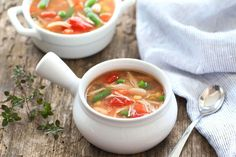 Chicken No-Noodle Soup with Veggies - raw boneless skinless chicken breasts, fat-free chicken broth, frozen petite mixed vegetables, cannellini/white kidney beans, canned stewed tomatoes, salt, black pepper, ground thyme, bay leaves