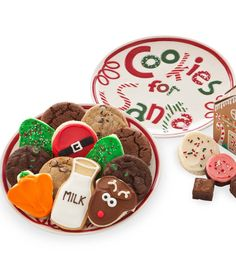 """Cookies For Santa plate with """"Milk"""" cookie plus a gingerbread house with treats $39 from Cheryl's"""