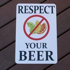 """Metal bar sign featuring a graphic of citrus fruit with a red circle with a line through it over the fruit. Text reads """"respect your beer""""."""