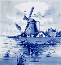 Carreau bleu de Delft. Moulin à vent et canal hollandais peints en bleu à la main.