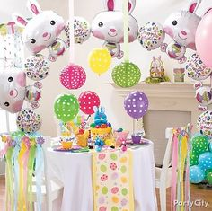 "Create an amazing Easter Bunny balloon ""rainbow"" arch! A little helium and tape make it easy. Click for our how-to tips!"