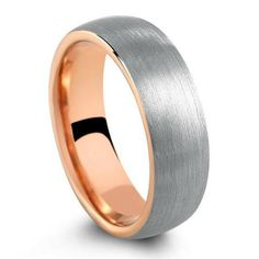 Black brushed tungsten wedding band with a high polish rose gold interior. The perfect modern mens tungsten wedding band. Black top and rose gold interior. Black Tungsten Rings, Tungsten Wedding Rings, Celtic Wedding Rings, Wedding Rings Rose Gold, Wedding Ring Bands, Groom, Ring Engraving, Tungsten Carbide, Ring Ring
