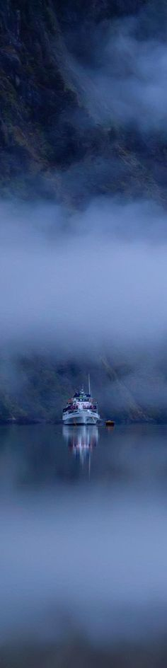 Boat in lonely mist, New Zealand