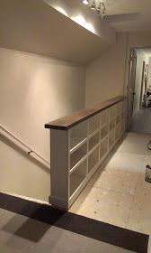 Elephant Buffet: How To Keep From Falling Down A Staircase- bookcase stair rail. Great storage idea!