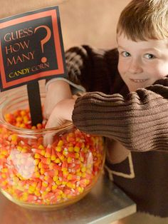 HALLOWEEN FUN~ Start the party with a guessing game challenge. Fill a clear bowl with candy corn, counting the pieces as you fill. Download and print our sign and glue. Ask kids to write their names and guesses on slips of paper. Award the child with the closest guess with a special carnival prize or the Jar of candy corn.