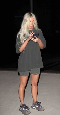 Pinterest: DEBORAHPRAHA ♥️ Kim Kardashian wearing all faded black shorts and tshirt from yeezy collection