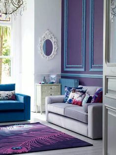 Very hip and youthful analogous living space. The deep blues and violets create a luxurious and fun hangout area.