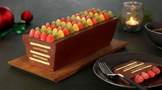Traditional Norwegian Christmas dessert, Delfia Cake. Chocolate mass layered with biscuits and marzipan, topped with jelly candy.  Delfiakake - MatPrat
